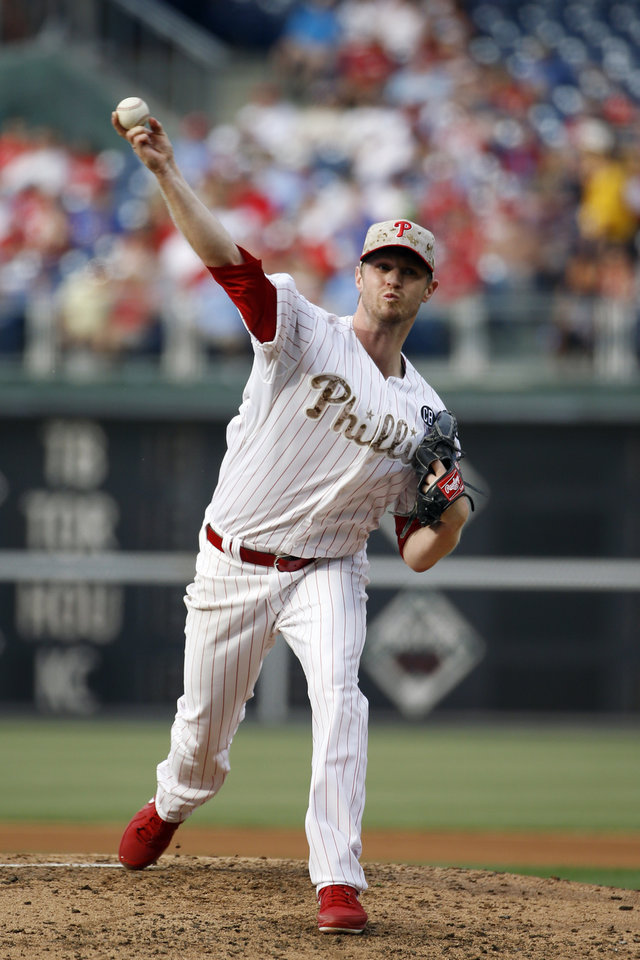Photo - Philadelphia Phillies' Kyle Kendrick pitches during the fourth inning of a baseball game against the Colorado Rockies, Monday, May 26, 2014, in Philadelphia. (AP Photo/Matt Slocum)