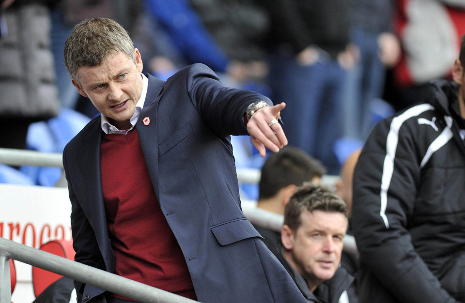 Photo - Cardiff City's manager Ole Gunnar Solskjaer  gestures, during their English Premier League match against Hull City,  at The Cardiff City Stadium, Cardiff,  Wales,  Saturday Feb. 22, 2014. (AP Photo/PA) UNITED KINGDOM OUT: NO SALES: NO ARCHIVE