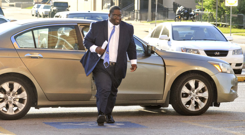Photo - Oklahoma City councilman John Pettis Jr. arrives at the Oklahoma County Jail in Oklahoma City, Okla. on Tuesday, May 15, 2018, to surrendered in his embezzlement case. Pettis posted a $10,000 bond, and was released to be arraigned in Oklahoma County Court court. Photo by Chris Landsberger, The Oklahoman