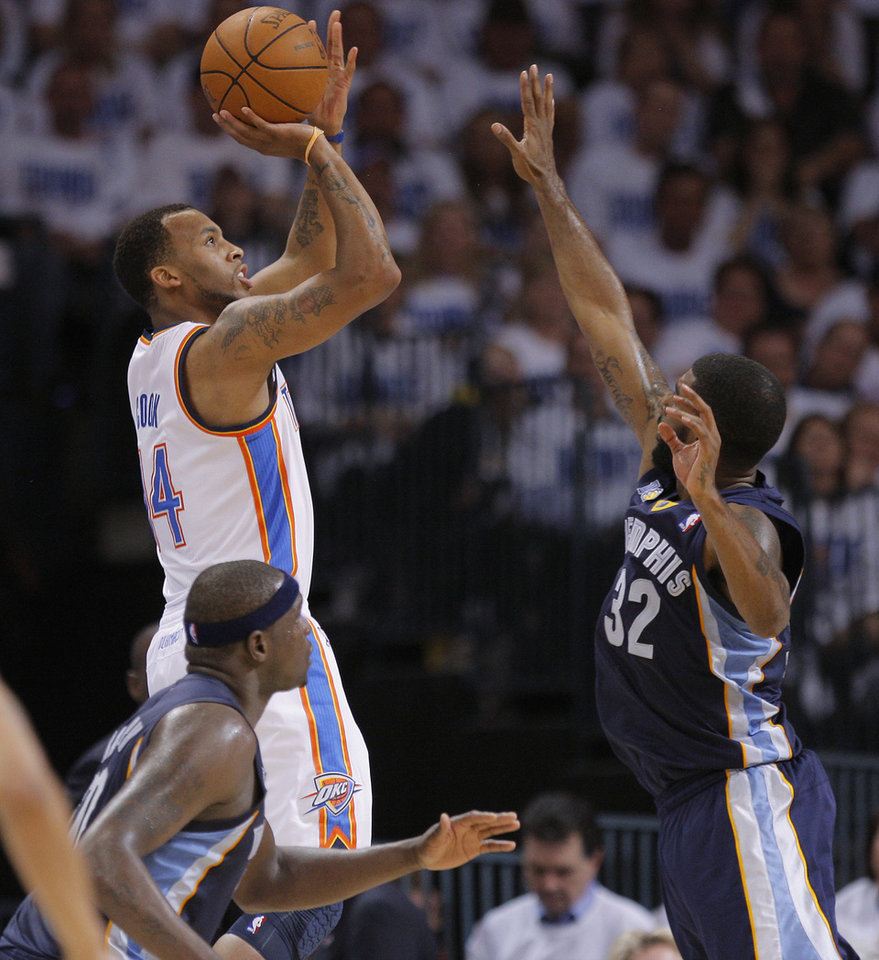 Photo - Oklahoma City's Daequan Cook (14) shoots the ball in front of O.J. Mayo (32) of Memphis during game five of the Western Conference semifinals between the Memphis Grizzlies and the Oklahoma City Thunder in the NBA basketball playoffs at Oklahoma City Arena in Oklahoma City, Wednesday, May 11, 2011. Photo by Bryan Terry, The Oklahoman