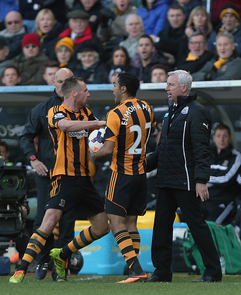 Photo - Newcastle United's manager Alan Pardew, right, and Hull City's David Meyler, left, confront each other during the English Premier League soccer match at the KC Stadium, Hull, England Saturday March 1, 2014. Newcastle manager Alan Pardew is facing a potentially lengthy touchline ban after appearing to head-butt Hull midfielder David Meyler in the English Premier League on Saturday. The touchline altercation overshadowed Newcastle's 4-1 victory over Hull.  (AP Photo/Lynne Cameron, PA)  UNITED KINGDOM OUT - NO SALES - NO ARCHIVES