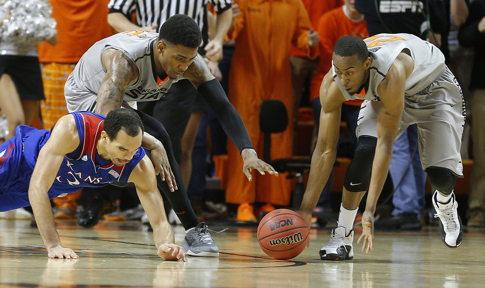Photo - Oklahoma State's Le'Bryan Nash (2) and Markel Brown (22) go for a loose ball beside Kansas' Perry Ellis (34) during an NCAA college basketball game between Oklahoma State University (OSU) and the University of Kansas at Gallagher-Iba Arena in Stillwater, Okla., Saturday, March 1, 2014. Oklahoma State won 72-65. Photo by Bryan Terry, The Oklahoman