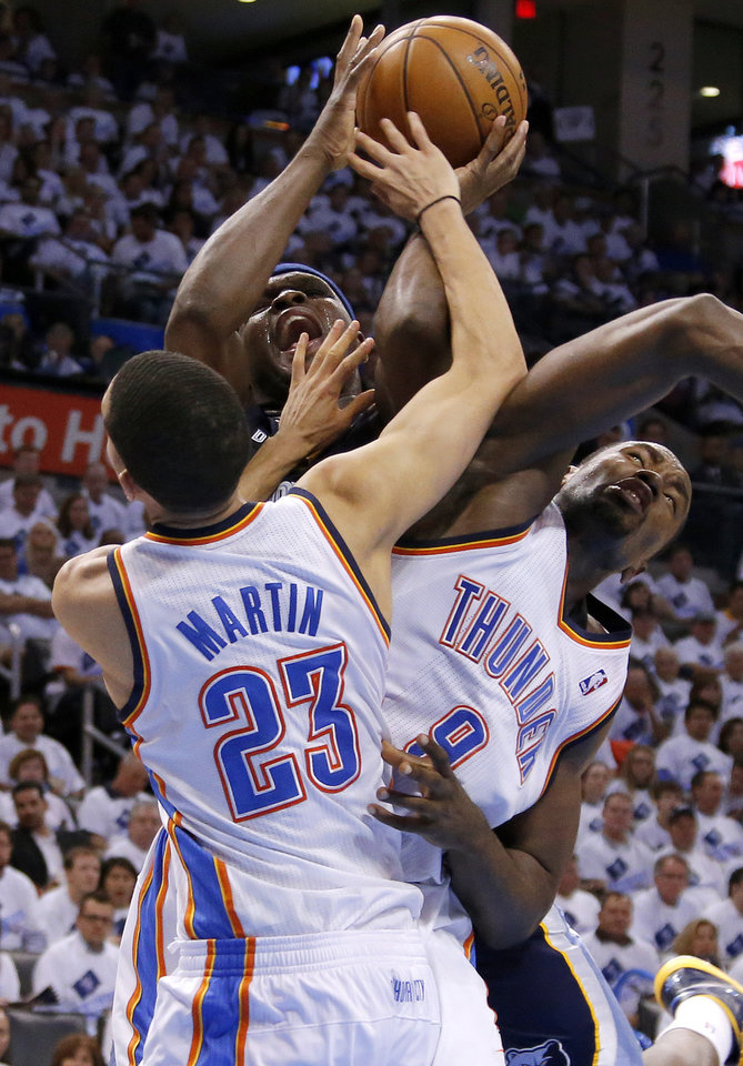Photo - Oklahoma City's Serge Ibaka (9) fouls Memphis' Zach Randolph (50) as Oklahoma City's Kevin Martin (23) helps defend during Game 5 in the second round of the NBA playoffs between the Oklahoma City Thunder and the Memphis Grizzlies at Chesapeake Energy Arena in Oklahoma City, Wednesday, May 15, 2013.  Photo by Bryan Terry, The Oklahoman