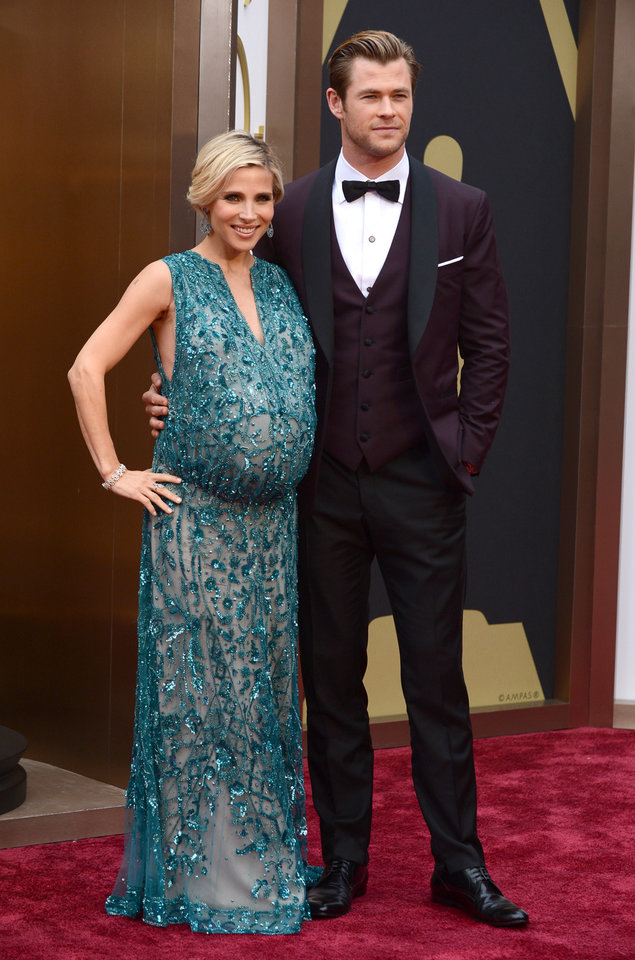 Photo - Elsa Pataky, left, and Chris Hemsworth arrive at the Oscars on Sunday, March 2, 2014, at the Dolby Theatre in Los Angeles.  (Photo by Jordan Strauss/Invision/AP)