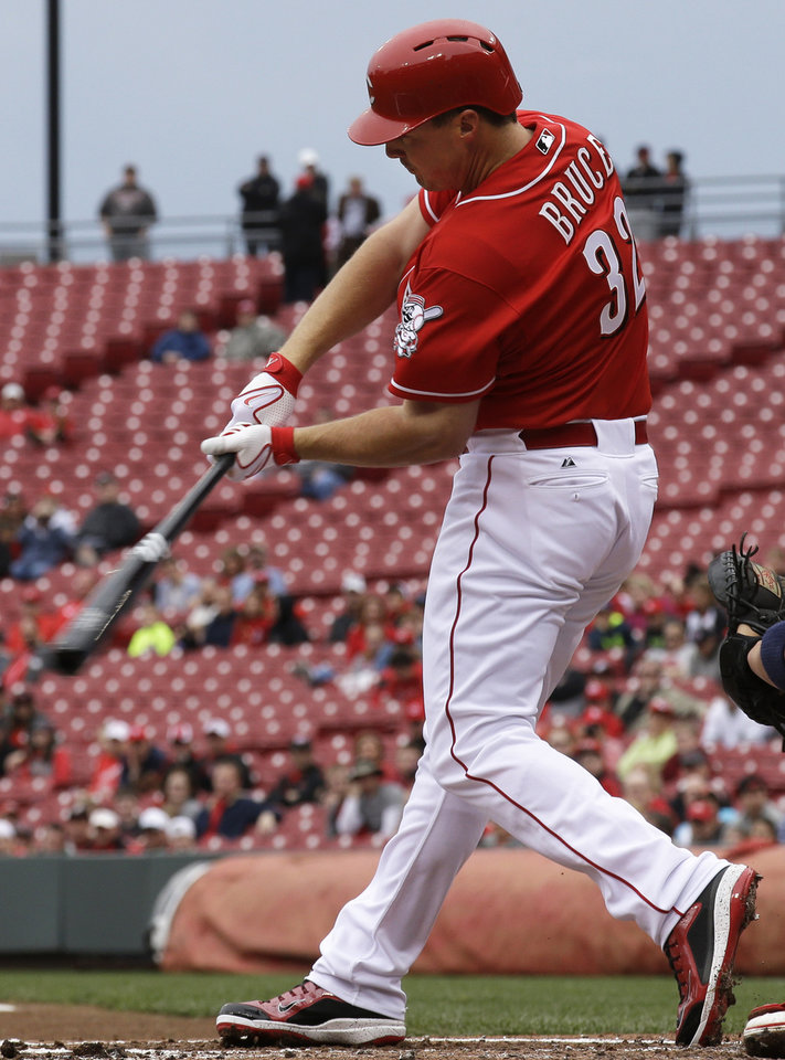 Photo - Cincinnati Reds' Jay Bruce hits a two-run home run off St. Louis Cardinals starting pitcher Lance Lynn in the first inning of a baseball game on Thursday, April 3, 2014, in Cincinnati. (AP Photo/Al Behrman)