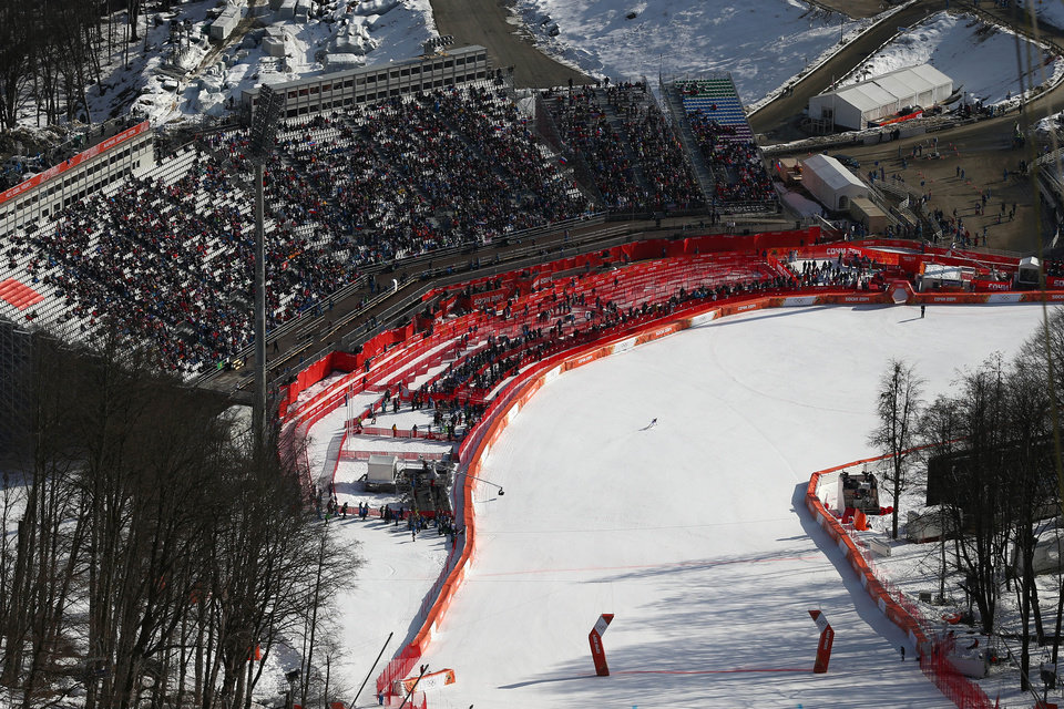 Photo - United States' Julia Mancuso finishes in the downhill portion of the women's supercombined at the Sochi 2014 Winter Olympics, Monday, Feb. 10, 2014, in Krasnaya Polyana, Russia. (AP Photo/Alessandro Trovati)