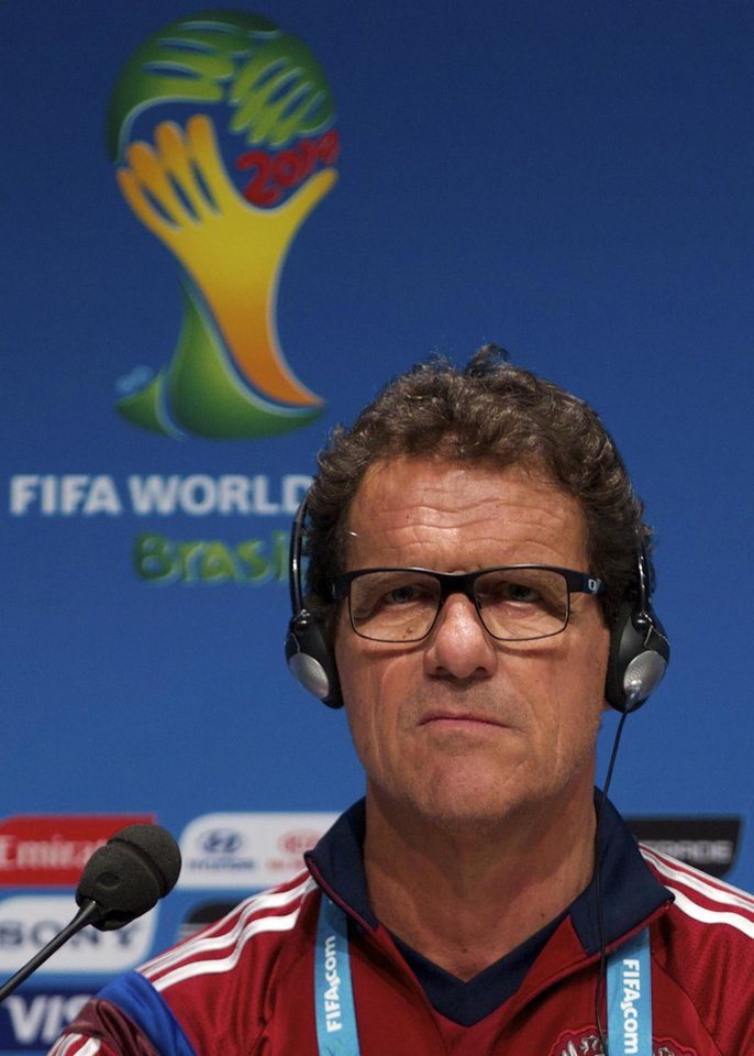 Photo - Fabio Capello, Italian coach of Russian national soccer team, listens to a question during a news conference at the Maracana stadium in Rio de Janeiro, Brazil, on Saturday, June 21, 2014. Russia will play next game against Belgium in group H of the 2014 soccer World Cup. (AP Photo/Ivan Sekretarev)
