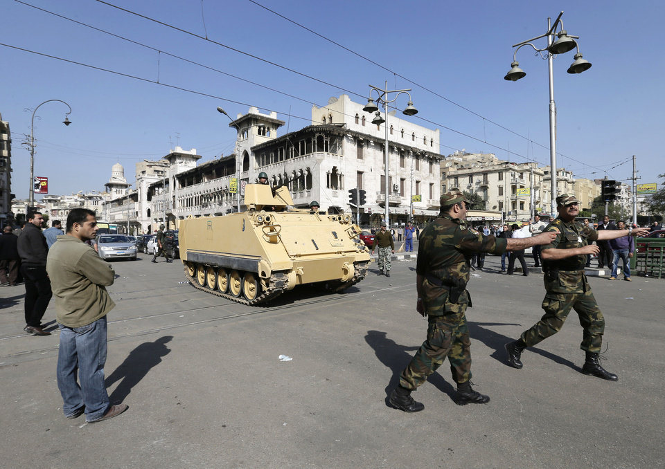 Photo - Egyptian Army deploy near the presidential palace to secure the site of overnight clashes between supporters and opponents of President Mohammed Morsi in Cairo, Egypt, Thursday, Dec. 6, 2012. The Egyptian army has deployed tanks outside the presidential palace in Cairo following clashes between supporters and opponents of Mohammed Morsi that left several people dead and hundreds wounded. (AP Photo/Hassan Ammar)