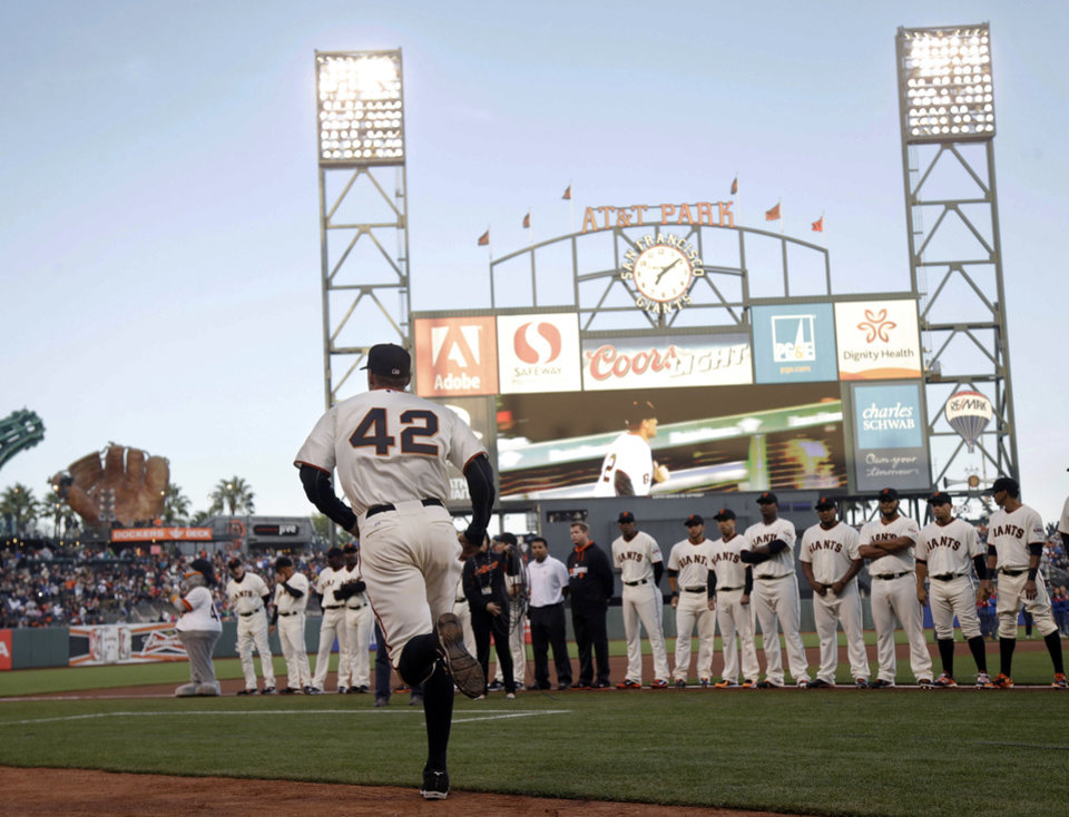 Photo - San Francisco Giants right fielder Hunter Pence wears Jackie Robinson's No. 42 as he is introduced before the Giants' baseball game against the Los Angeles Dodgers on Tuesday, April 15, 2014, in San Francisco. (AP Photo/Marcio Jose Sanchez)