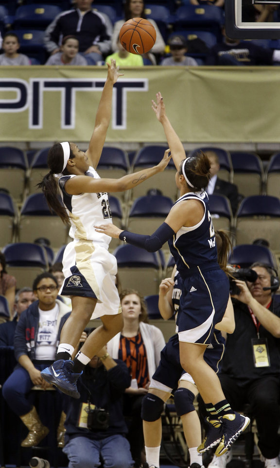 Photo - Pittsburgh's Chelsea Welch, left, shoots over Notre Dame's Kayla McBride during the first half of an NCAA college basketball game Thursday, Jan. 16, 2014, in Pittsburgh. (AP Photo/Keith Srakocic)