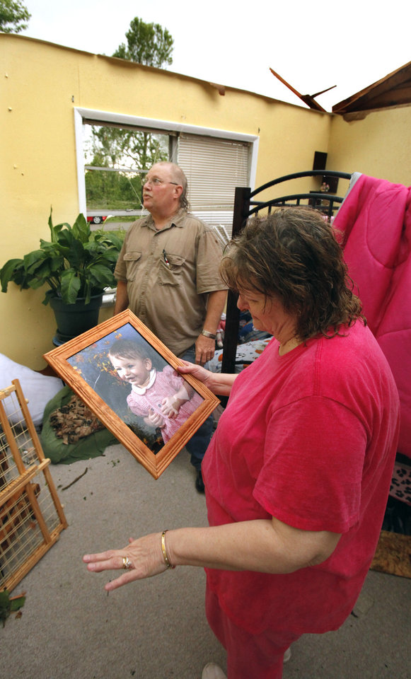 Photo - Lee and Debra Merideth collect  valuables from their roofless home after a tornado-spawning storm swept through the state on Tuesday, May 24, 2011, in Newcastle, Okla. Photo by Steve Sisney, The Oklahoman ORG XMIT: KOD