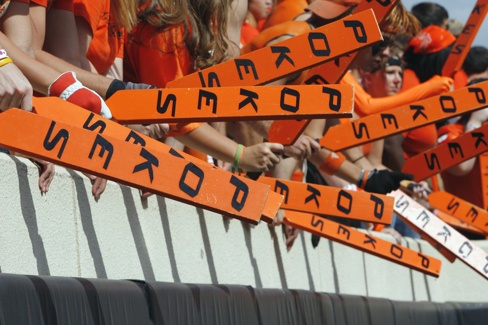 Photo - Cowboy fans wield big sticks during the college football game between the Oklahoma State University Cowboys (OSU) and the University of Kansas Jayhawks (KU) at Boone Pickens Stadium in Stillwater, Okla., Saturday, Oct. 8, 2011 Photo by Steve Sisney, The Oklahoman