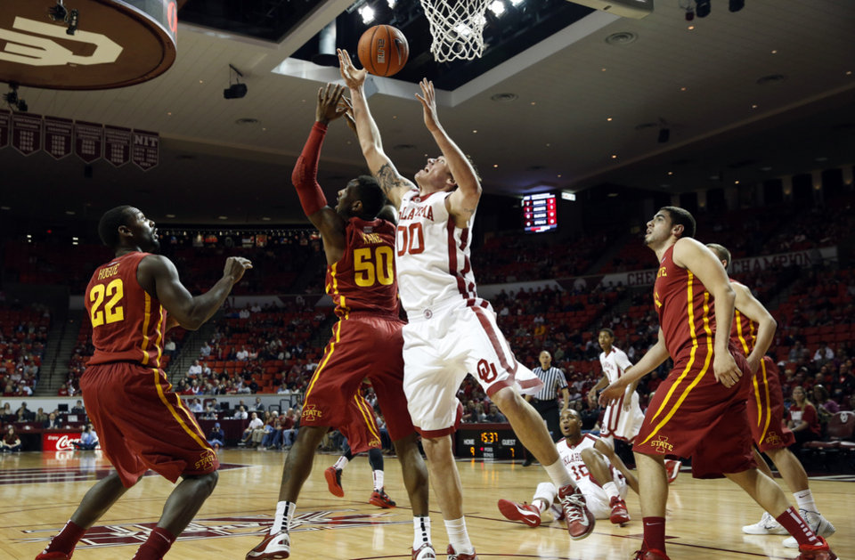 Photo - Oklahoma Sooner's Ryan Spangler (00) gets an offensive rebound in the first half as the University of Oklahoma Sooners (OU) men play the Iowa State Cyclones (ISU) in NCAA, college basketball at The Lloyd Noble Center on Saturday, Jan. 11, 2014  in Norman, Okla. Photo by Steve Sisney, The Oklahoman