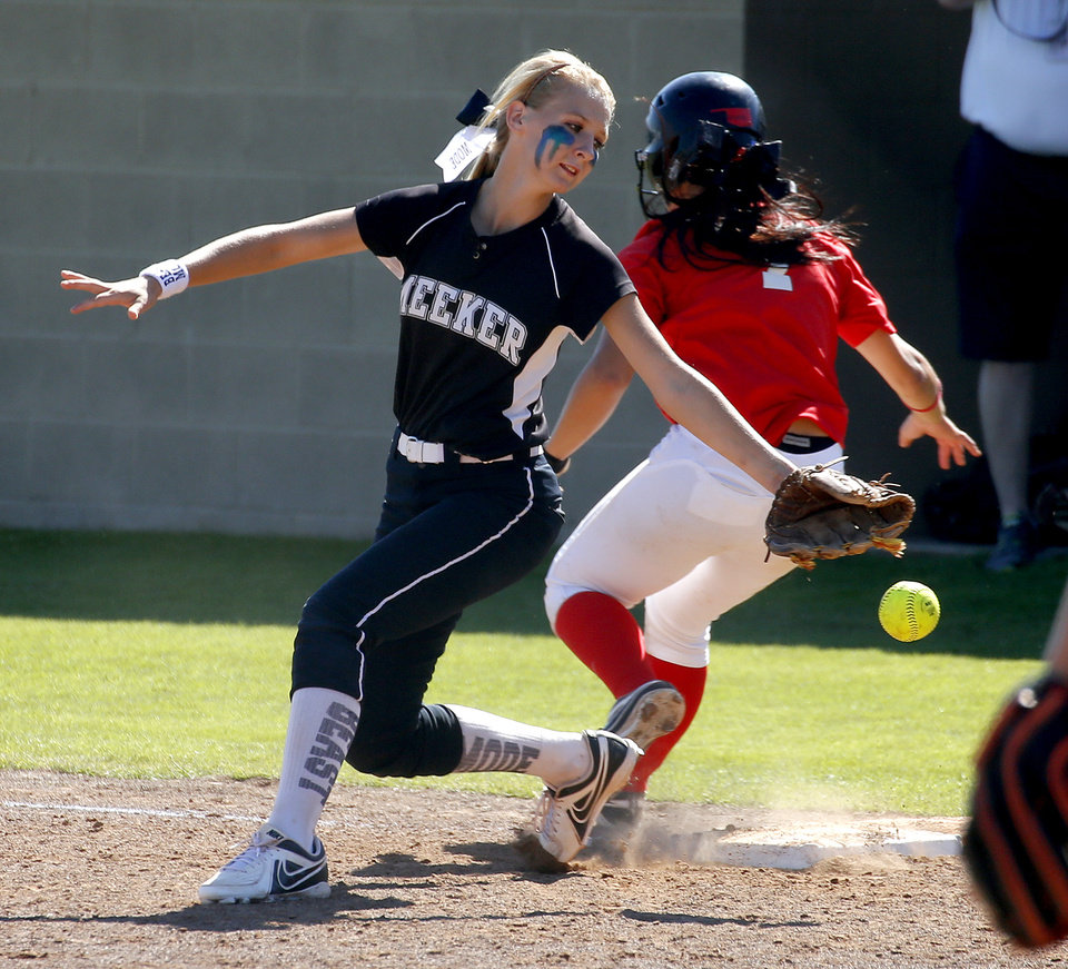 The ball goes past Meeker's Amaris Stansell as Washington's Kelsey Harmon runs by on her way to second in the fourth inning  of their a Class 3A state softball tournament game at The Ball Fields at Firelake in Shawnee, Okla., Thursday, October 10, 2013. Washington won 2-1. Photo by Bryan Terry, The Oklahoman