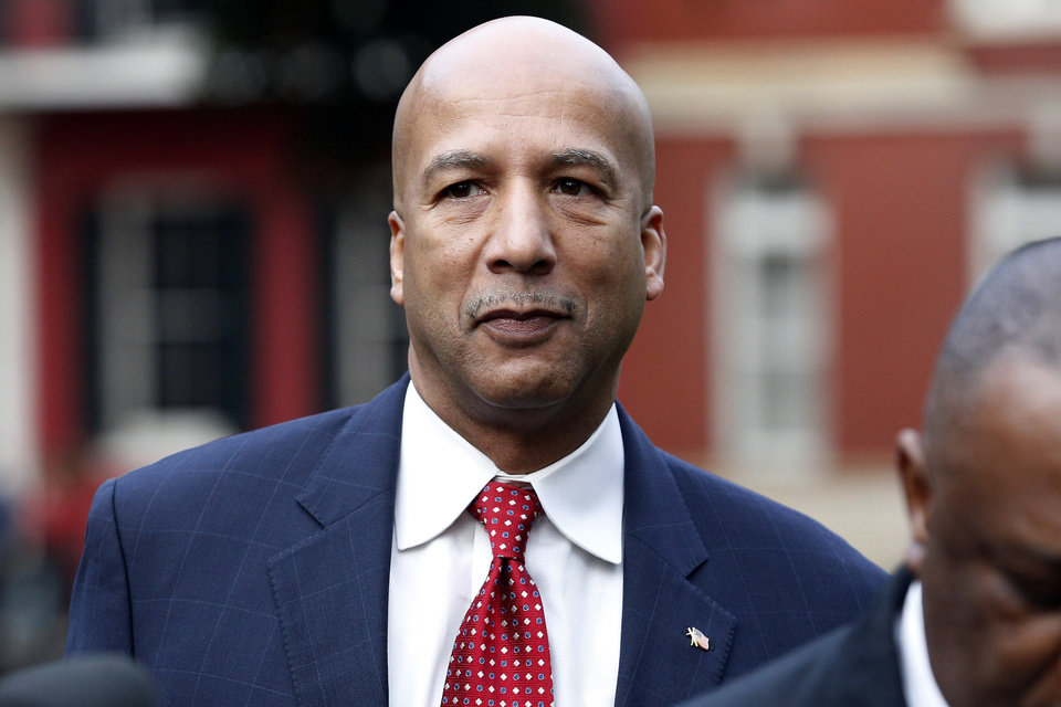 Photo - Former New Orleans Mayor Ray Nagin arrives at the Hale Boggs Federal Building in New Orleans, Monday, Jan. 27, 2014. Jury selection begins Monday in the trial of Nagin, who faces charges that he accepted bribes and free trips among other things from contractors in exchange for helping them secure millions of dollars in city work.  (AP Photo/Jonathan Bachman)