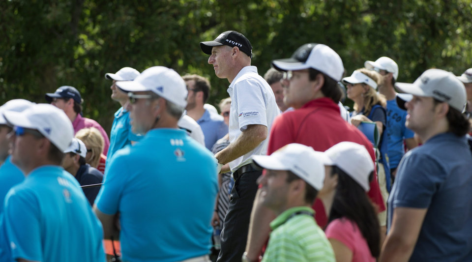 Photo - Jim Furyk watches his ball after hitting on the ninth tee during the third round of the Canadian Open golf championship at the Royal Montreal Golf Club in Montreal, Saturday, July 26, 2014. (AP Photo/The Canadian Press, Paul Chiasson)