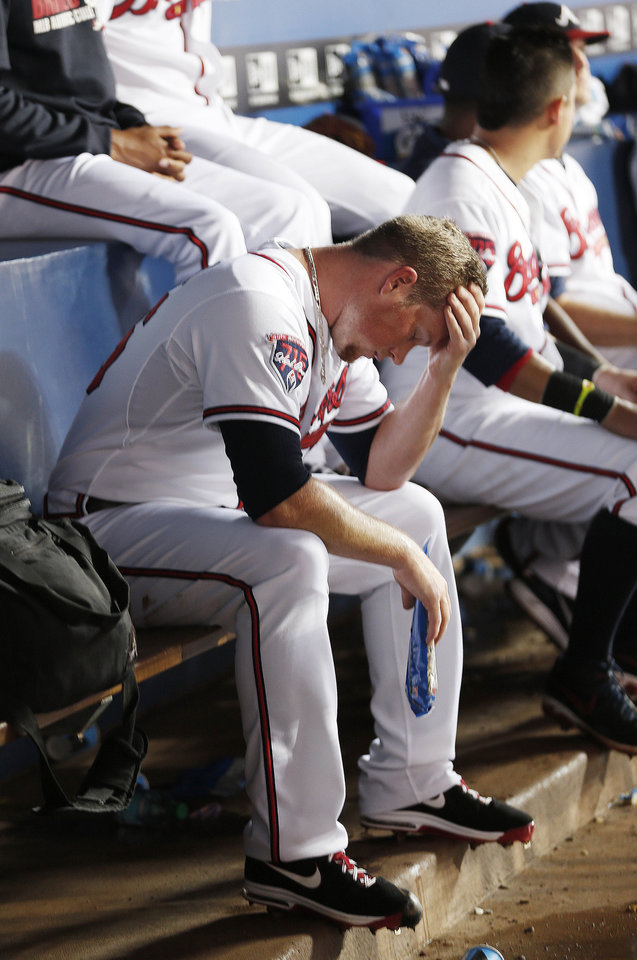 Photo - Atlanta Braves relief pitcher Craig Kimbrel sits on the bench as the Braves bat in the ninth inning of a baseball game against the Miami Marlins, Thursday, July 24, 2014, in Atlanta. Miami won 3-2 and Kimbrel was credited with a loss. (AP Photo)