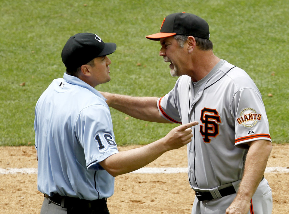 Photo -   San Francisco Giants manager Bruce Bochy, right, argues with home plate umpire Mike DiMuro after being tossed from the game during the seventh inning in an MLB baseball game against the Arizona Diamondbacks Sunday, April 8, 2012, in Phoenix.(AP Photo/Ross D. Franklin)