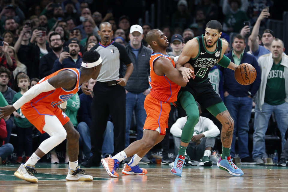 Photo - Oklahoma City Thunder's Chris Paul (3) defends against Boston Celtics' Jayson Tatum (0) during the second half of an NBA basketball game, Sunday, March, 8, 2020, in Boston. (AP Photo/Michael Dwyer)