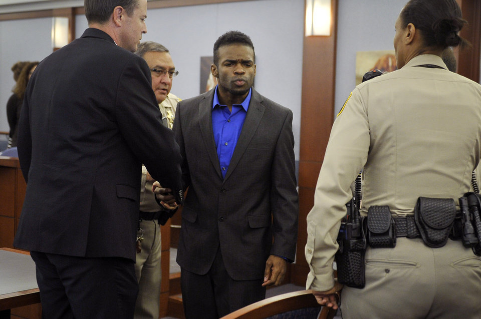 Photo - Jason Omar Griffith, center, blows a kiss to his mother before being lead away and after a guilty verdict was read during his murder trial at the Regional Justice Center on Thursday, May 22, 2014, in Las Vegas. Griffith was convict of second degree murder of his girlfriend and Luxor