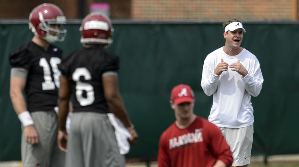 Photo - Alabama offensive coordinator/quarterbacks coach Lane Kiffen, right, works with the quarterbacks during spring NCAA college football practice, Saturday, March 15, 2014, at the Thomas-Drew Practice Facility in Tuscaloosa, Ala. (AP Photo/Alabama Media Group, Vasha Hunt) MAGS OUT
