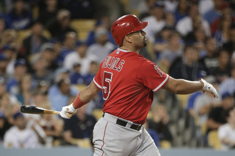 Photo - Los Angeles Angels' Albert Pujols watches his home run during the eighth inning of a baseball game against the Los Angeles Dodgers on Tuesday, Aug. 5, 2014, in Los Angeles. (AP Photo/Jae C. Hong)