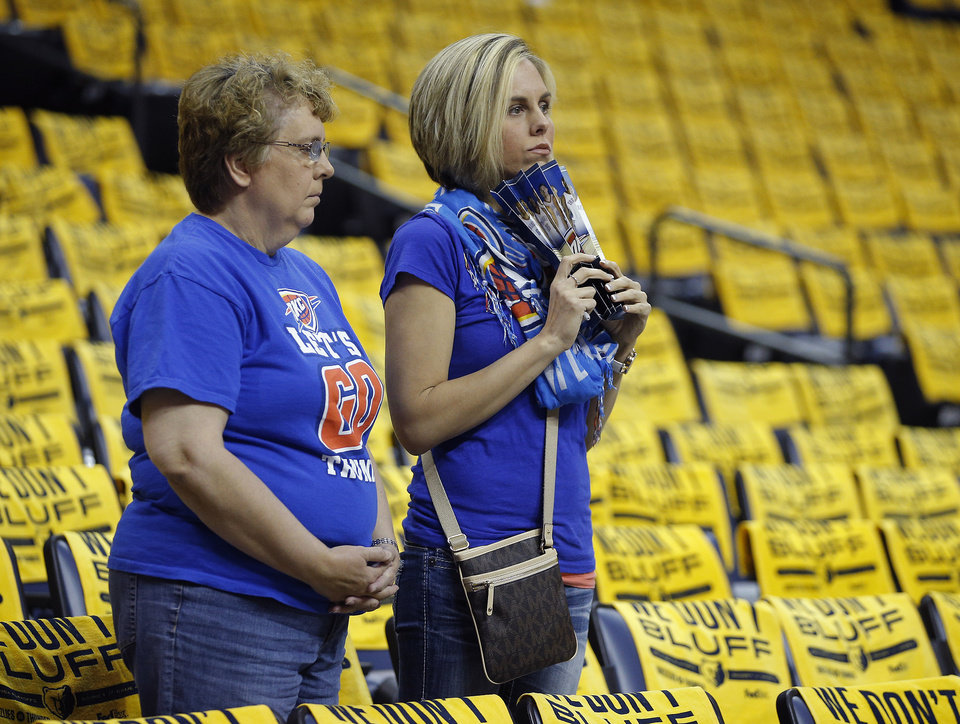 Photo - Oklahoma City fans Nancy Altman, left, and Lisa Brown of Kingfisher, Okla., wait for the start of Game 4 in the first round of the NBA playoffs between the Oklahoma City Thunder and the Memphis Grizzlies at FedExForum in Memphis, Tenn., Saturday, April 26, 2014. Photo by Bryan Terry, The Oklahoman