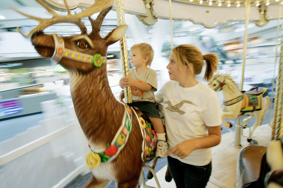Photo -  Cody Medina, two years old when this photo was taken in 2006, and his sister Ashley Medina, then 14, were among countess kids who enjoyed carousel rides at Crossroads Mall between 2003 and 2017. [THE OKLAHOMAN ARCHIVES]
