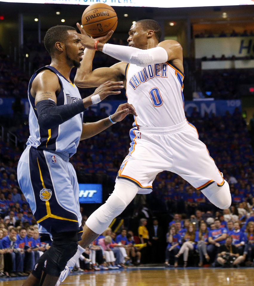 Photo - Oklahoma City's Russell Westbrook (0) passes from beside Memphis' Mike Conley (11) during Game 7 in the first round of the NBA playoffs between the Oklahoma City Thunder and the Memphis Grizzlies at Chesapeake Energy Arena in Oklahoma City, Saturday, May 3, 2014. Photo by Nate Billings, The Oklahoman
