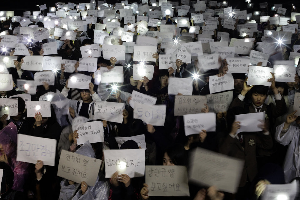 Photo - Danwon High School students hold papers with messages such as