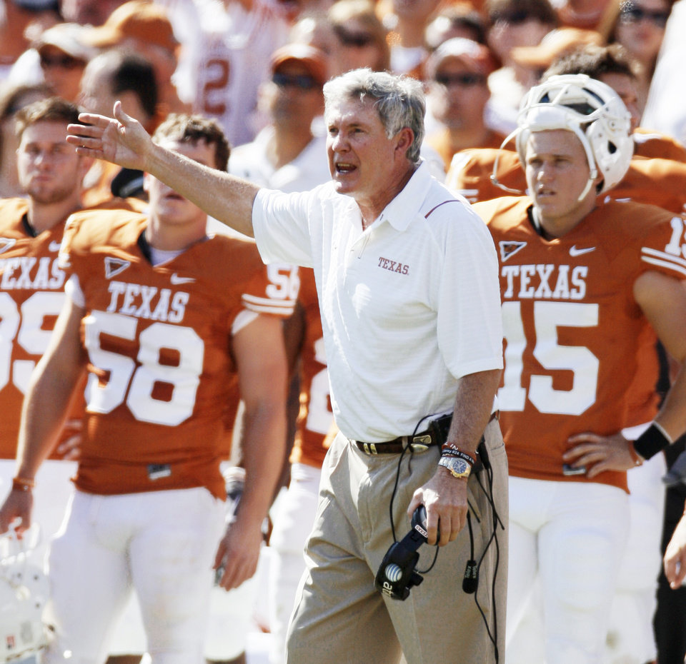 Photo - The Texas football team is by far the biggest money-maker in the new potential Pac-10 Conference.  AP PHOTO