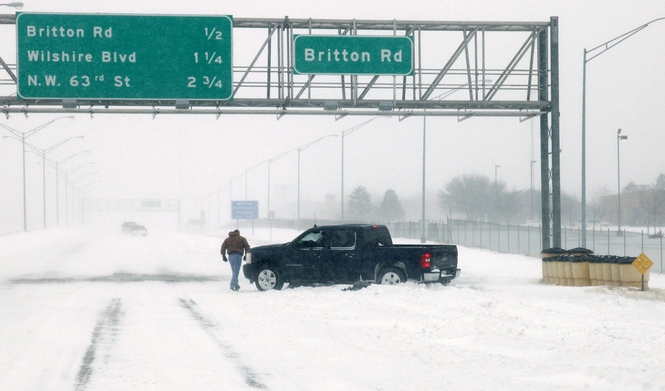 Photo - A motorist gets stuck in drifts on south bound I-235 near Britton Road during a major winter storm that hit central Oklahoma Tuesday, Feb. 1, 2011. Photo by Doug Hoke, The Oklahoman.
