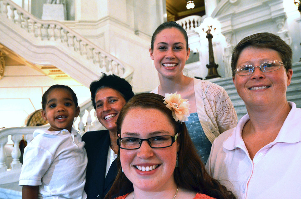 Photo - In this July 9, 2013 file photo, the Whitewoods, left to right, Landon, Susan,  Abbey, Katie, and Deb, pose together after a news conference to announce that Deb and Susan are the lead plaintiffs in a lawsuit seeking to overturn a state law effectively banning same-sex marriage in Pennsylvania, in Harrisburg, Pa.  Pennsylvania's ban on gay marriage was overturned Tuesday May 20, 2014 by a federal judge in a decision that makes same-sex marriage legal throughout the Northeast. (AP Photo/Marc Levy)