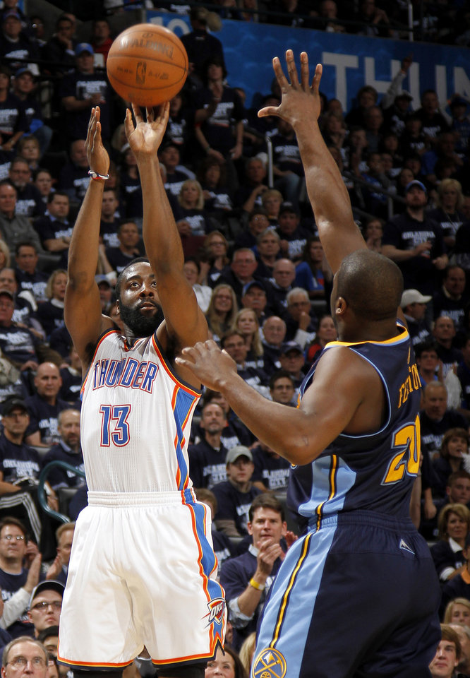Photo - Oklahoma City's James Harden (13) shoots the ball beside Denver's Raymond Felton (20) during the NBA basketball game between the Denver Nuggets and the Oklahoma City Thunder in the first round of the NBA playoffs at the Oklahoma City Arena, Wednesday, April 27, 2011. Photo by Bryan Terry, The Oklahoman