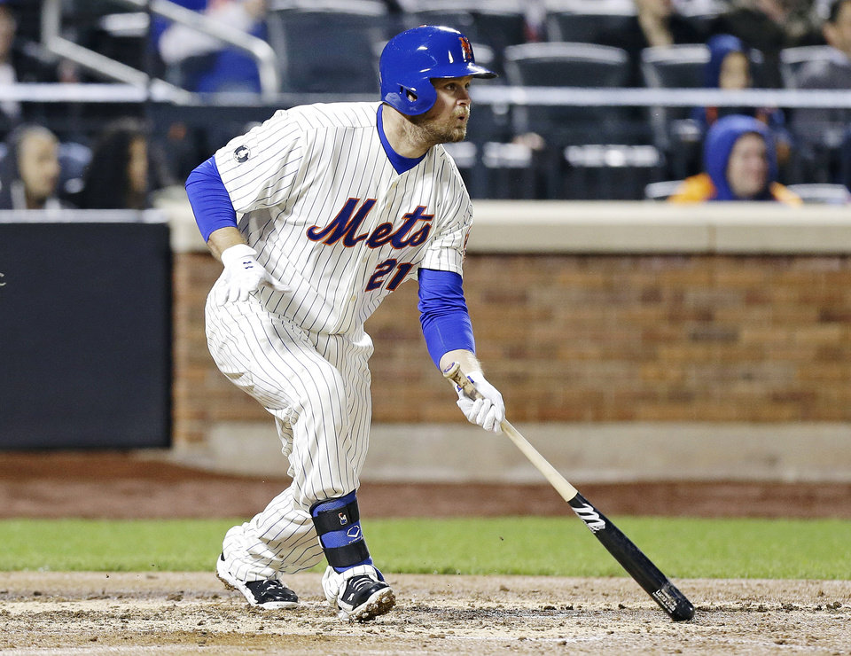 Photo - New York Mets' Lucas Duda (21) follows through on a two-run single during the third inning of a baseball game against the Miami Marlins, Saturday, April 26, 2014, in New York. (AP Photo/Frank Franklin II)