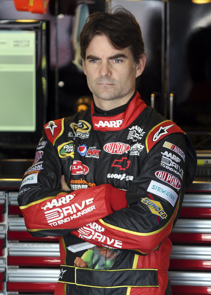 Photo -   FILE - In this Oct. 12, 2012 file photo, Jeff Gordon waits before practice for the NASCAR Bank of America 500 Sprint Cup series auto race in Concord, N.C. NASCAR has a real dilemma on its hands with this whole Gordon mess hanging over the season finale, Sunday, Nov. 18, 2012 at Homestead-Miami Speedway. (AP Photo/Bob Jordan, File)