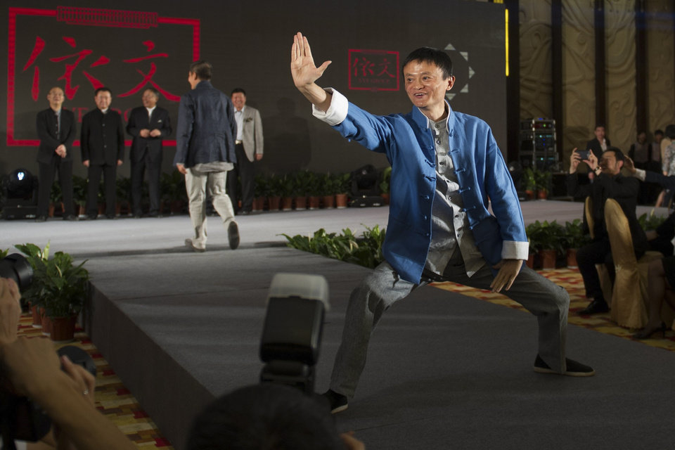 Photo - In this April 21, 2013 photo, Jack Ma, chairman of the world's largest e-commerce group Alibaba, poses during a show at the annual Summit of China Green Companies in Kunming, in southwestern China's Yunnan province. Even before Alibaba went online, the founder talked about making the fledgling e-commerce company a global player. (AP Photo) CHINA OUT