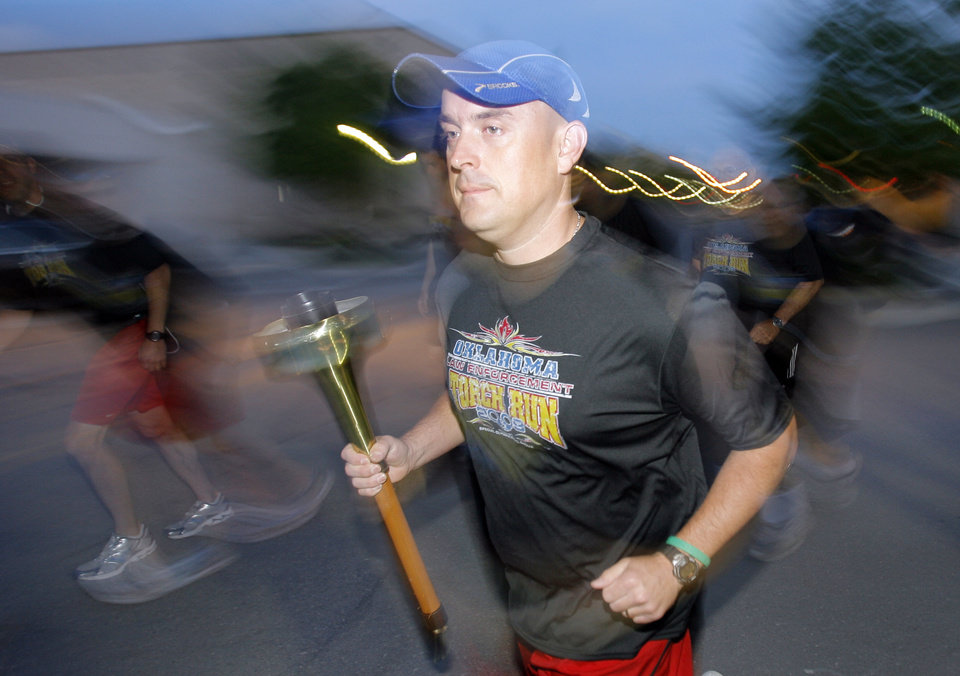 Tommy Evans starts the Edmond police Special Olympics Torch Run from the police station to Stillwater, Wednesday, May 13, 2009.   Photo By David McDaniel, The Oklahoman.