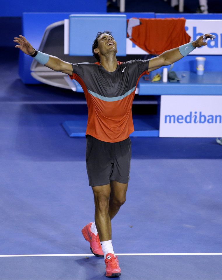Photo - Rafael Nadal of Spain celebrates after defeating Roger Federer of Switzerland during their semifinal at the Australian Open tennis championship in Melbourne, Australia, Friday, Jan. 24, 2014.(AP Photo/Aijaz Rahi)