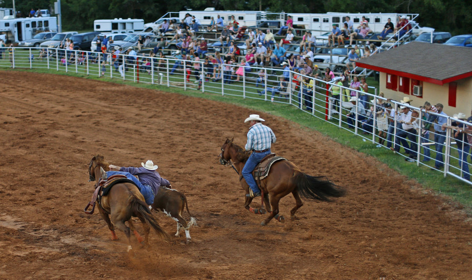 A contestant competes in steer wrestling the during the LibertyFest Rodeo in Edmond, Okla., Saturday, June, 22, 2013. Photo by Bryan Terry, The Oklahoman
