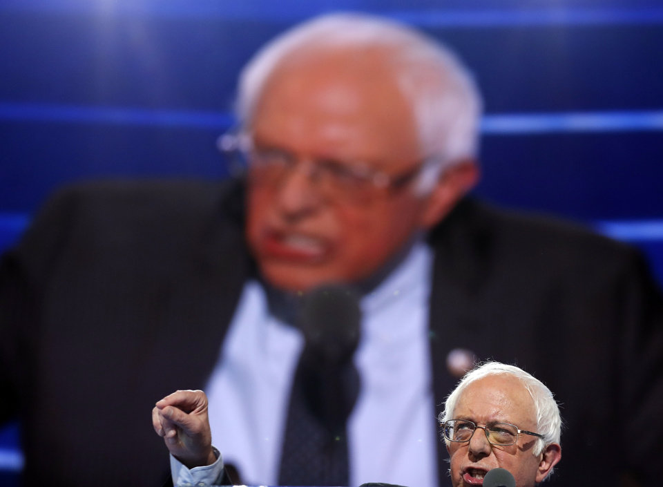 Photo - Former Democratic Presidential candidate, Sen. Bernie Sanders, I-Vt., speaks during the first day of the Democratic National Convention in Philadelphia , Monday, July 25, 2016. (AP Photo/Carolyn Kaster)