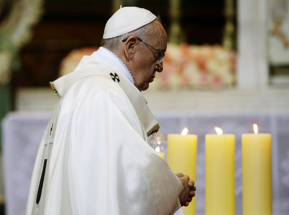 Photo - Pope Francis celebrates a Mass of reconciliation at Seoul's main cathedral, in South Korea, Monday, Aug. 18, 2014. Pope Francis wrapped up his first trip to Asia on Monday by challenging Koreans - from the North and the South -  to reject the