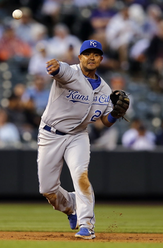 Photo - Kansas City Royals second baseman Christian Colon throws out Colorado Rockies' Drew Stubbs at first to end the third inning of a baseball game Wednesday, Aug. 20, 2014, in Denver. (AP Photo/Jack Dempsey)