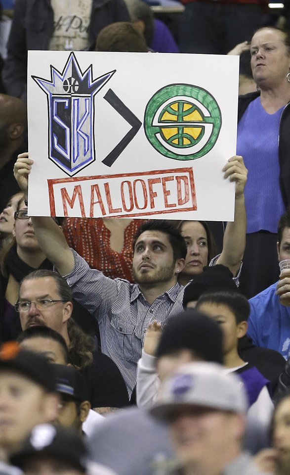 Photo - A Sacramento Kings fan Geral McDaniel displays his feelings toward the Maloof family, the owners of the team, before the Kings' NBA basketball game against the Dallas Mavericks in Sacramento, Calif., Thursday, Jan. 10, 2013. Word of the possible sale of the team to a group that would move the franchise to Seattle has Kings fan showing their support with hopes they will remain in Sacramento. (AP Photo/Rich Pedroncelli)