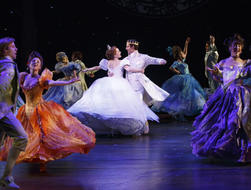 Photo - This theater image released by Sam Rudy Media Relations shows Laura Osnes as Cinderella, center left, dancing with Santino Fontana as the Prince, during a performance of