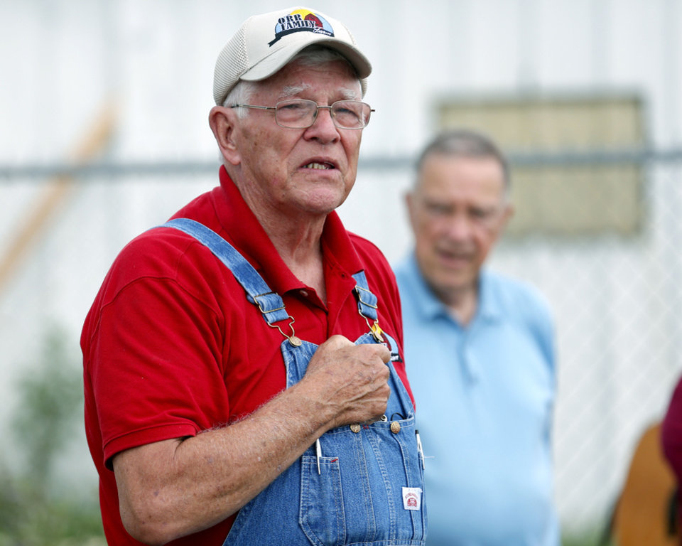 Photo - Dr. Glenn Orr, a retired veterinarian and co-owner of the Orr Family Farm, speaks to guests during a memorial held Saturday at the farm, 14400 S Western, to honor animals who died in recent tornadoes.   SARAH PHIPPS - SARAH PHIPPS