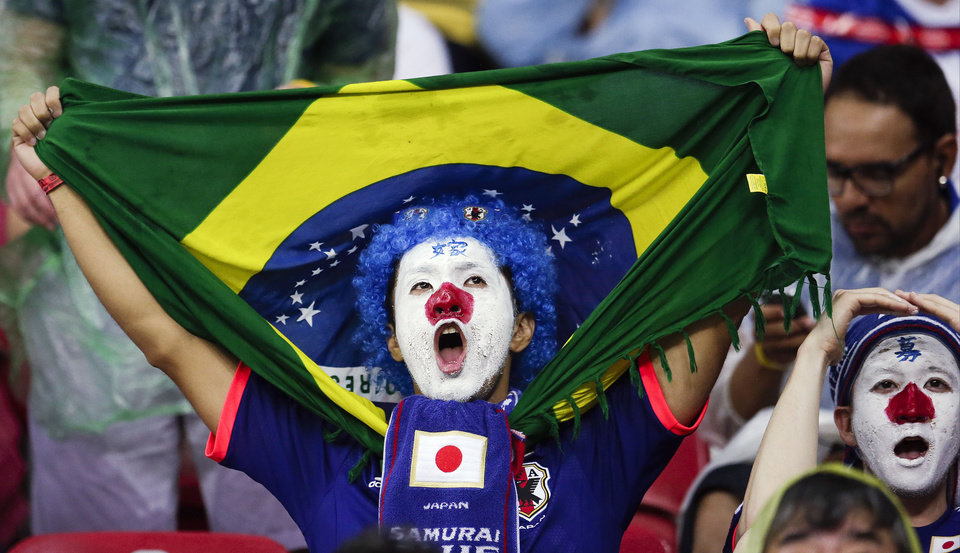 Photo - A Japanese fan cheers before the start of the group C World Cup soccer match between Ivory Coast and Japan at the Arena Pernambuco in Recife, Brazil, Saturday, June 14, 2014. (AP Photo/Petr David Josek)