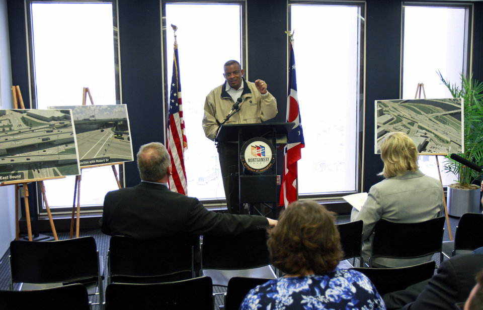Photo - This photo taken April 14, 2014 shows Transportation Secretary Anthony Foxx speaking to the media and local government officials  about federal transportation funding at the Montgomery County Commissioner's office in Dayton, Ohio.  On the road in a tour bus this week, Foxx is urging Congress to quickly approve legislation to pay for highway and transit programs amid warnings that the U.S. government's Highway Trust Fund is nearly broke. If allowed to run dry, that could threaten to set back or shut down projects across the country, force widespread layoffs of construction workers and delay needed repairs and improvements.  (AP Photo/Skip Peterson)