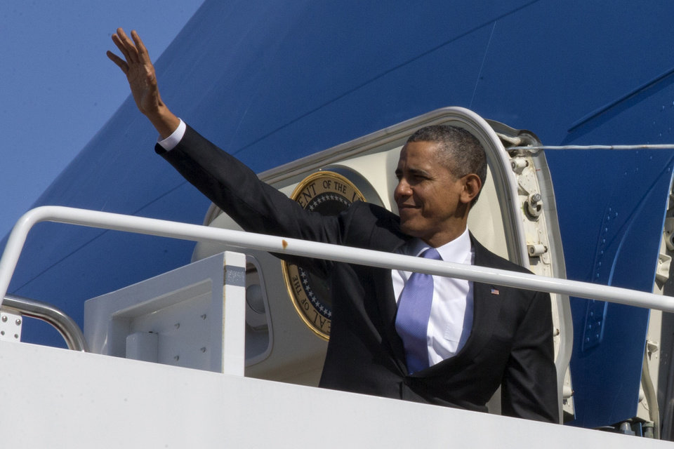 Photo - President Barack Obama waves he boards Air Force One at Andrews Air Force Base, Md., Friday, Feb. 14, 2014, en route to travel to Fresno, Calif., to discuss the ongoing drought. (AP Photo/Jacquelyn Martin)