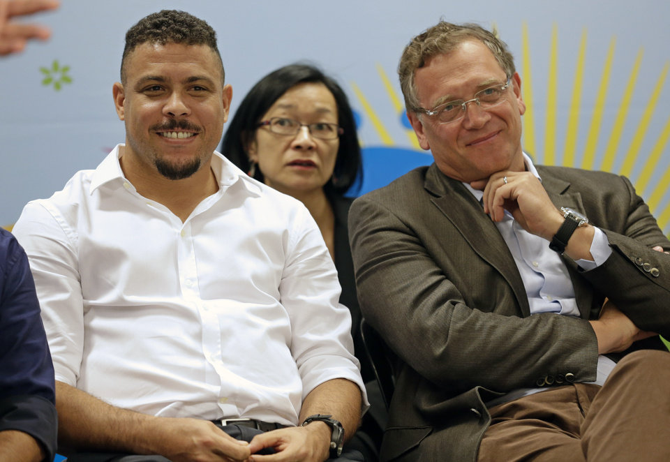 Photo - Brazil's former soccer player Ronaldo, left, and FIFA Secretary General Jerome Valcke attend a news conference after inspecting the unfinished Itaquerao stadium in Sao Paulo, Brazil, Tuesday, April 22, 2014. The stadium will host the World Cup opener match between Brazil and Croatia in June 12. (AP Photo/Andre Penner)